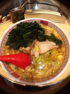 Soy based broth ramen with pork and topped with seaweed.